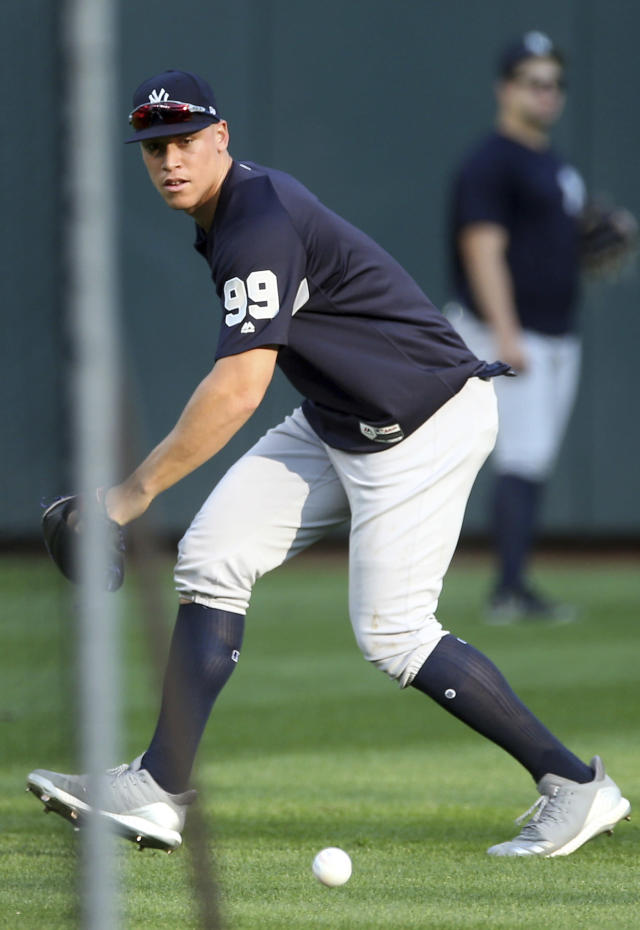 New York Yankees' Aaron Judge fields a grounder during batting practice before a baseball game against the Minnesota Twins Wednesday, Sept. 12, 2018, in Minneapolis. (AP Photo/Jim Mone)