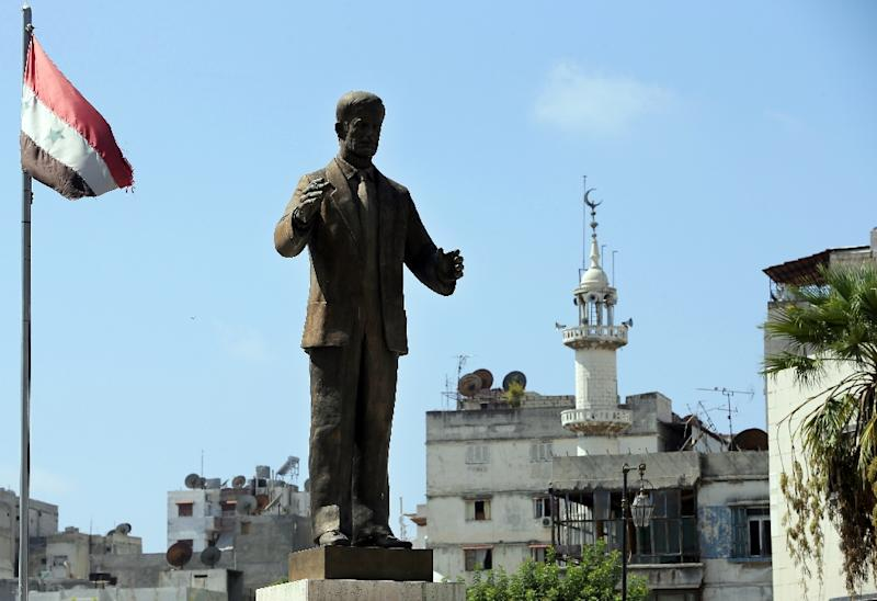 A statue of late former Syrian president Hafez al-Assad, father President Bashar al-Assad, stands at the main square of the coastal city of Latakia (AFP Photo/Joseph Eid)