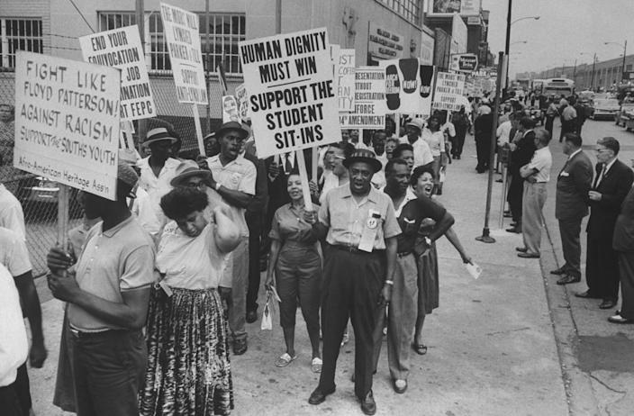 Civil rights demonstration addressing education rights outside GOP convention hall, 1960's.