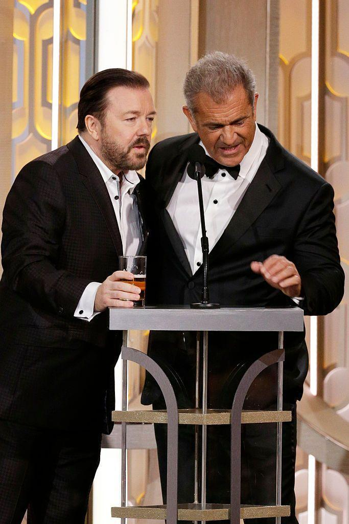 """<p>As if <a href=""""https://www.etonline.com/news/179697_ricky_gervais_whispers_mel_gibson_golden_globes_sugar_tits"""" rel=""""nofollow noopener"""" target=""""_blank"""" data-ylk=""""slk:slamming Mel with jokes"""" class=""""link rapid-noclick-resp"""">slamming Mel with jokes</a> before introducing him on stage wasn't cringe-y enough, things got even more tense when <a href=""""https://www.amazon.com/Passion-Christ-Jim-Caviezel/dp/B007HU4FJ8/?tag=syn-yahoo-20&ascsubtag=%5Bartid%7C10063.g.35393430%5Bsrc%7Cyahoo-us"""" rel=""""nofollow noopener"""" target=""""_blank"""" data-ylk=""""slk:The Passion of the Christ"""" class=""""link rapid-noclick-resp""""><em>The Passion of the Christ</em></a> director fought back with jabs of his own in 2016. """"I love seeing Ricky once every three years because it reminds me to get a colonoscopy,"""" Mel said before <a href=""""https://www.youtube.com/watch?v=FDeYL_yhWnk"""" rel=""""nofollow noopener"""" target=""""_blank"""" data-ylk=""""slk:threatening to &quot;put him to sleep&quot;"""" class=""""link rapid-noclick-resp"""">threatening to """"put him to sleep""""</a>. Ricky then asked Mel (which was censored for TV), """"What the f--k does 'sugar t--s' mean?"""" in reference to Mel's <a href=""""http://www.tmz.com/2006/07/28/gibsons-anti-semitic-tirade-alleged-cover-up/"""" rel=""""nofollow noopener"""" target=""""_blank"""" data-ylk=""""slk:notorious law enforcement incident"""" class=""""link rapid-noclick-resp"""">notorious law enforcement incident</a> in 2006. The whole thing was one giant wince fest that left both audience members and <a href=""""https://twitter.com/search?q=ricky%20gervais%20mel%20gibson%20golden%20globes&src=typd"""" rel=""""nofollow noopener"""" target=""""_blank"""" data-ylk=""""slk:viewers at home"""" class=""""link rapid-noclick-resp"""">viewers at home</a> stunned.</p>"""