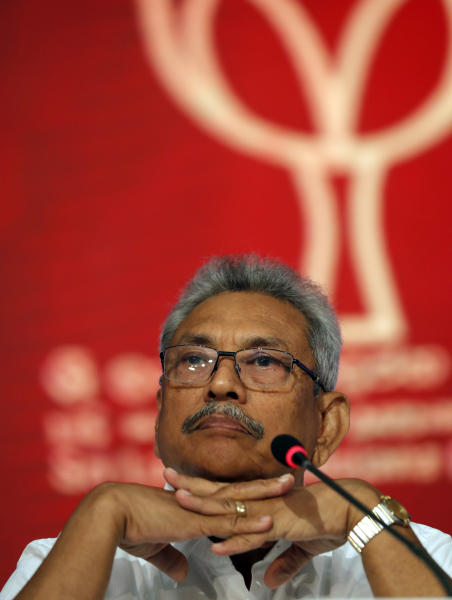 Sri Lankan presidential candidate and former defense chief Gotabaya Rajapaksa sits during a news conference in Colombo, Sri Lanka, Tuesday, Oct. 15, 2019. Rajapaksa, who's a front-runner in next month's presidential election says if he wins he won't recognize an agreement the government made with the U.N. human rights council to investigate alleged war crimes during the nation's civil war. (AP Photo/Eranga Jayawardena)