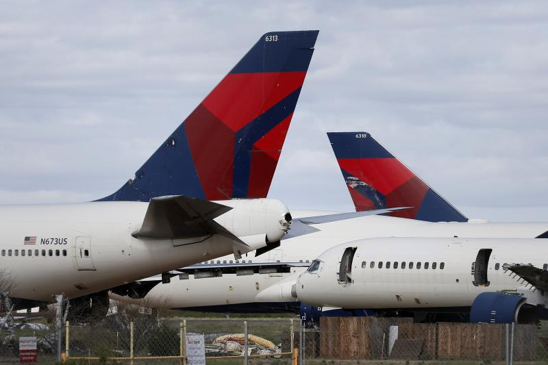 Mothballed Delta Air Lines passenger planes are joined by recently arrived Delta airplanes at Pinal Airpark Wednesday, March 18, 2020, in Red Rock, Ariz., as many passenger planes are being kept at the facility as airlines cut back on service due to the coronavirus COVID-19 pandemic. (AP Photo/Ross D. Franklin)