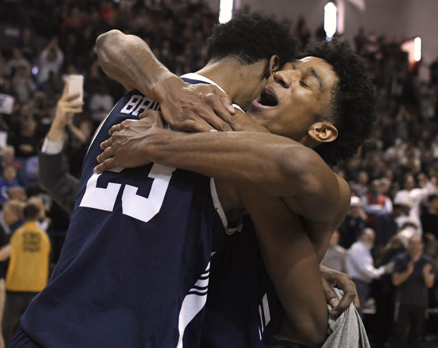 Yale's Trey Phills, right, celebrates with teammate Jordan Bruner, left, after their Ivy League championship win over Harvard in an NCAA college basketball game at Yale University in New Haven, Conn., Sunday, March 17, 2019, in New Haven, Conn. (AP Photo/Jessica Hill)