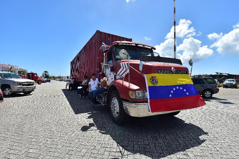 One of the red trucks waiting at a port in the Caribbean island of Curacao to take aid to Venezuela (AFP Photo/Luis ACOSTA            )