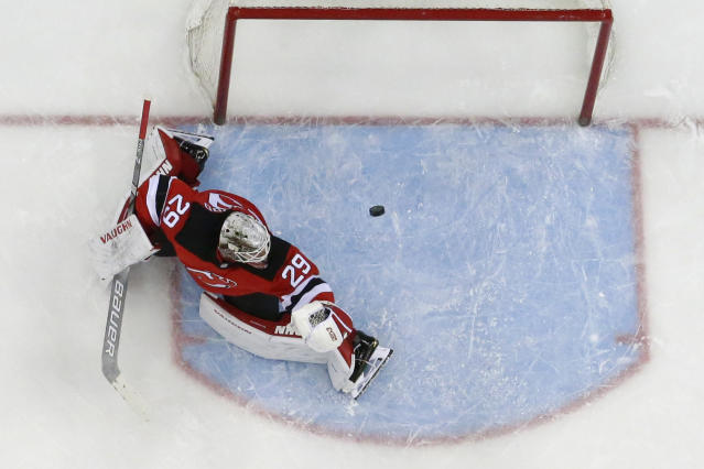 A shot by Washington Capitals left wing Andre Burakovsky, not visible, of Austria, gets by New Jersey Devils goaltender MacKenzie Blackwood (29) for a goal in the first period of an NHL hockey game, Tuesday, March 19, 2019, in Newark, N.J. The Capitals won 4-1. (AP Photo/Julio Cortez)