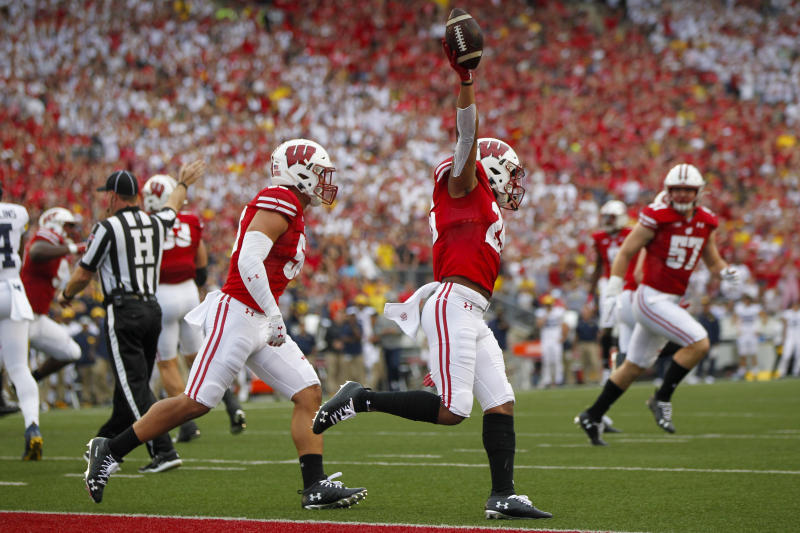 Wisconsin running back Jonathan Taylor celebrates a touchdown against Michigan during the first half of an NCAA college football game Saturday, Sept. 21, 2019, in Madison, Wis. Wisconsin won 35-14. (AP Photo/Andy Manis)