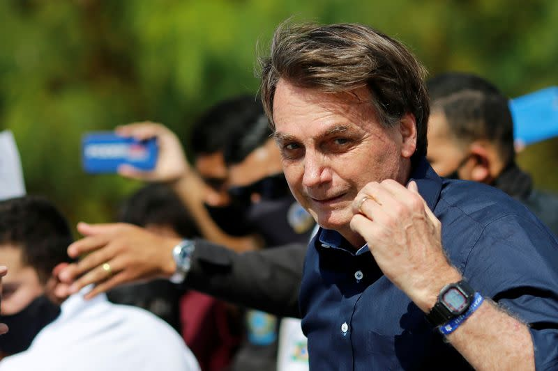 Bolsonaro joins protesters as Brazil political scandal heats up amid pandemic