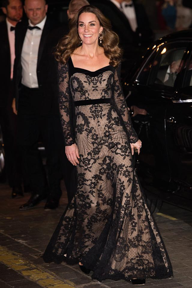 in an Alexander McQueen floor-length long-sleeve lace gown at the Royal Variety Performance in London.