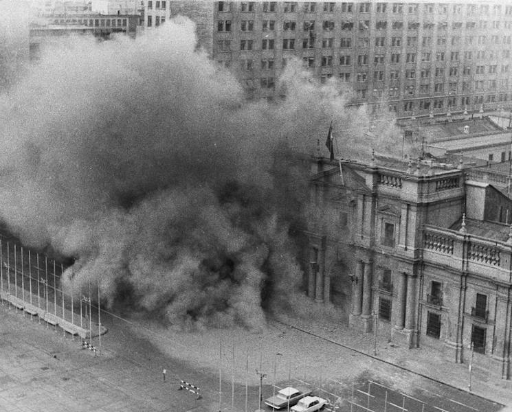FILE - In this Sept. 11, 1973 file photo, La Moneda presidential palace is bombed during a military coup to oust President Salvador Allende after which Gen. Augusto Pinochet seized power in Santiago, Chile. As bombs fell and rebelling troops closed in on the national palace, Allende avoided surrender by shooting himself with an assault rifle, ending Chile's experiment in nonviolent revolution and beginning 17 years of dictatorship. (AP Photo/File)