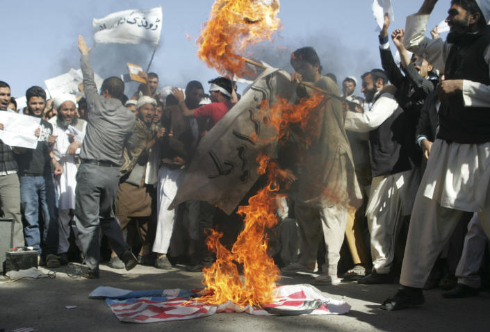 Afghans burn the U.S. flag in Herat, west of Kabul, Afghanistan, Sunday, Sept. 16, 2012, during a protest against an Internet video mocking the Prophet Muhammad that many fear could further aggravate Afghan-U.S. relations. The video has sparked protests throughout the Muslim world and the Afghan government blocked the YouTube site that hosts the video and its parent company, Google Inc., over the weekend in a move to prevent violent protests. (AP Photo/Hoshang Hashimi)