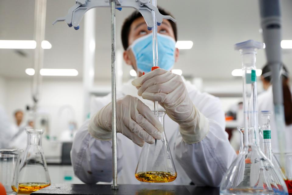 A man works in a laboratory of Chinese vaccine maker Sinovac Biotech, developing an experimental coronavirus disease (COVID-19) vaccine, during a government-organized media tour in Beijing, China, September 24, 2020. REUTERS/Thomas Peter     TPX IMAGES OF THE DAY