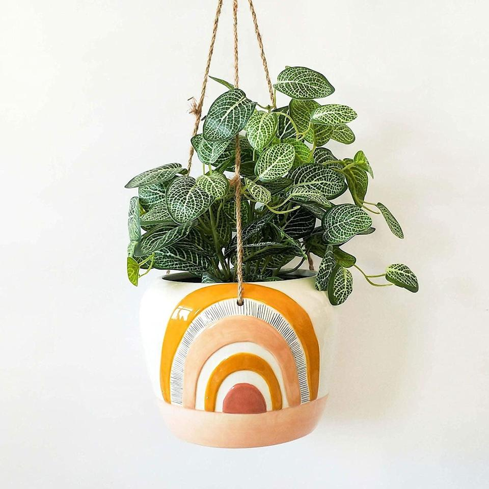 <p>Add some color to your space with this warm-toned <span>Urban Rainbow Hanging Indoor Planter</span> ($40).</p>