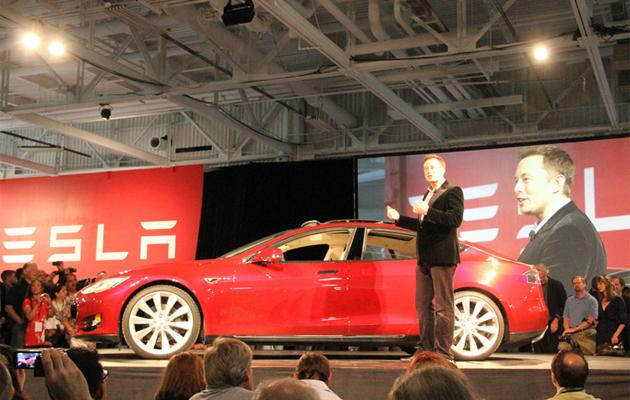 Elon Musk, CEO of Tesla Motors, introduces customers to the Model S sedan at the company's Fremont factory.