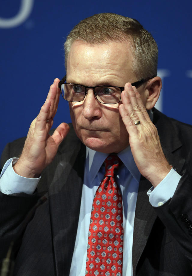 New Kansas athletic director Jeff Long adjusts his glasses during a news conference in Lawrence, Kan., Wednesday, July 11, 2018. (AP Photo/Orlin Wagner)