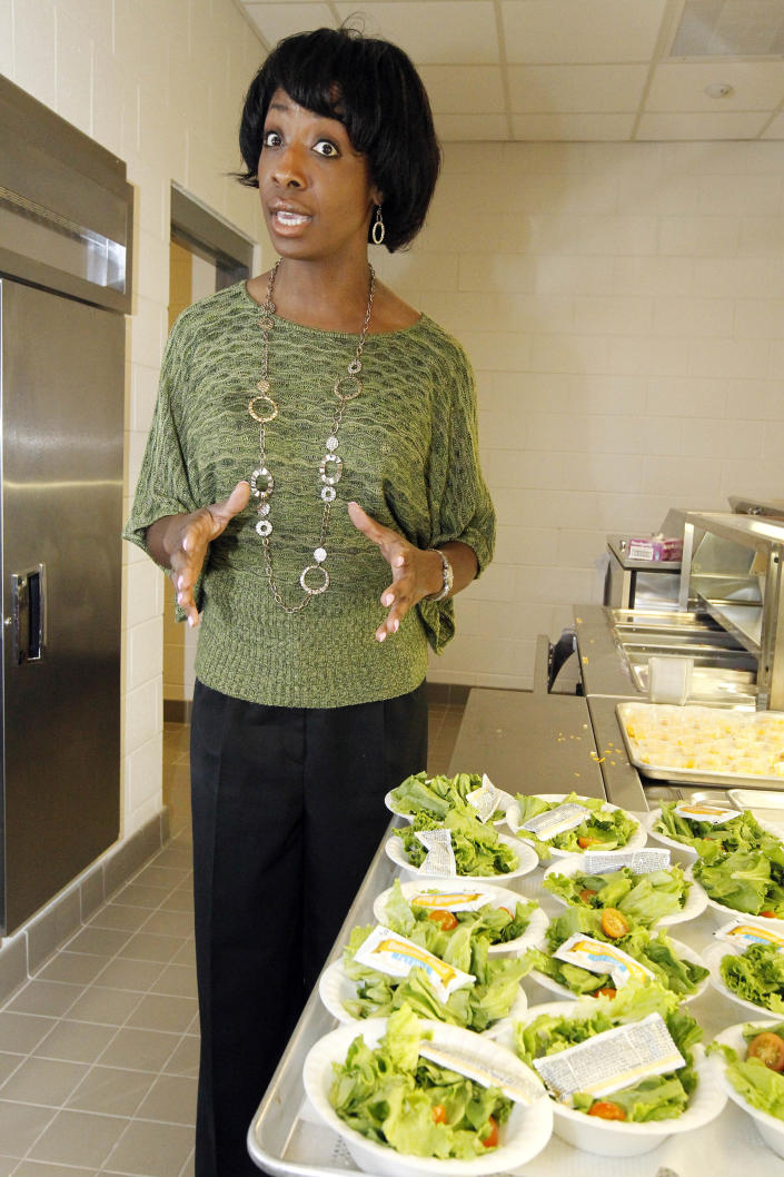 Keba Laird, child nutrition supervisor for the Clinton, Miss., school system, discusses how the color of vegetables helps with the development of nutritious lunches that are available at Eastside Elementary School in Clinton, Miss., Wednesday, Sept. 12, 2012. The leaner, greener school lunches served under new federal standards are getting mixed grades from students. (AP Photo/Rogelio V. Solis)