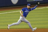Toronto Blue Jays third baseman Cavan Biggio (8) catches a hit by Miami Marlins Jesus Aguilar during the eighth inning of a baseball game, Wednesday, June 23, 2021, in Miami. (AP Photo/Marta Lavandier)
