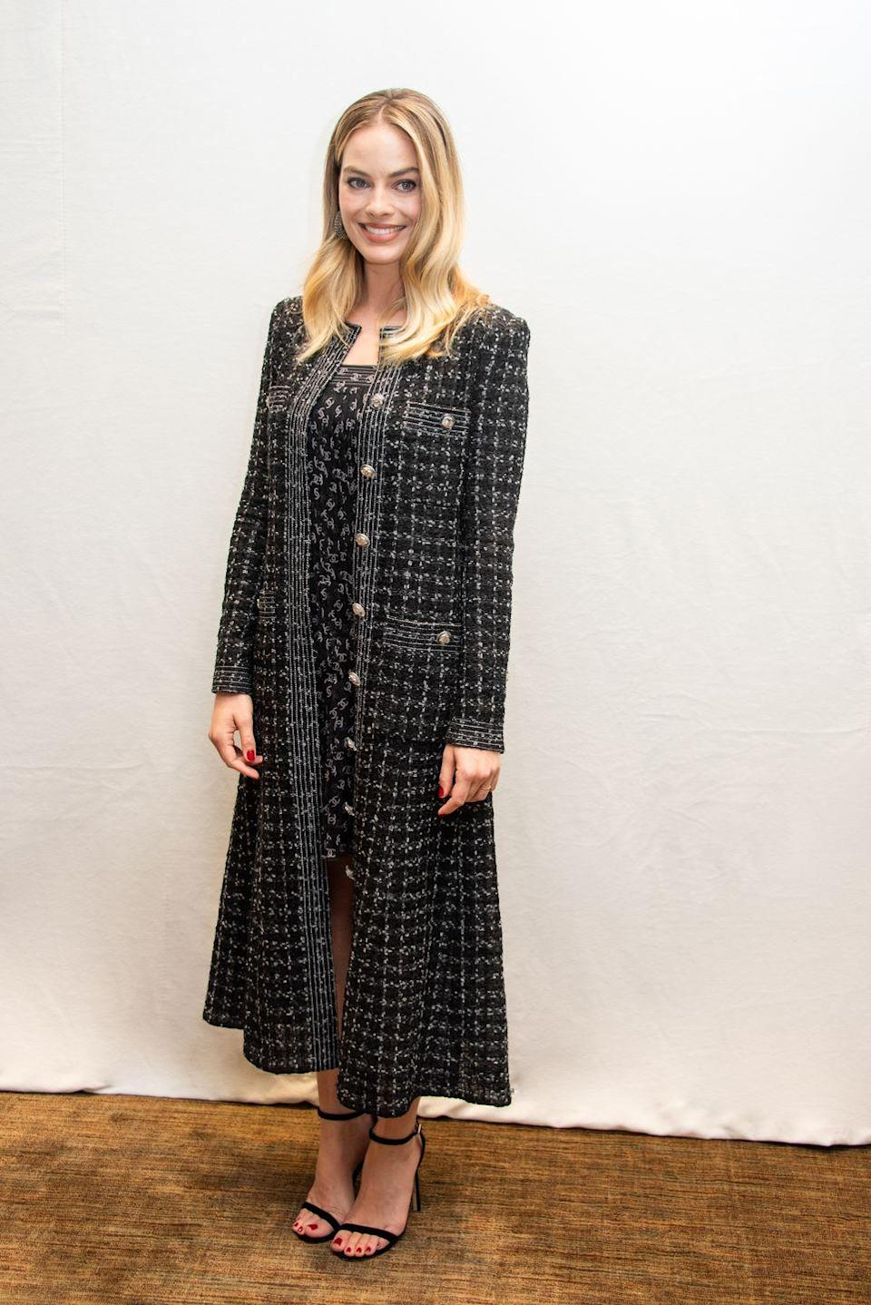 """<p>The actress wore a black and white Chanel dress and longline coat on Sunday in Los Angeles for the press conference for her upcoming film, <a href=""""https://www.elle.com/uk/life-and-culture/culture/a28781859/bombshell-margot-robbie-nicole-kidman-true-story/"""" rel=""""nofollow noopener"""" target=""""_blank"""" data-ylk=""""slk:Bombshell"""" class=""""link rapid-noclick-resp"""">Bombshell</a>.</p>"""