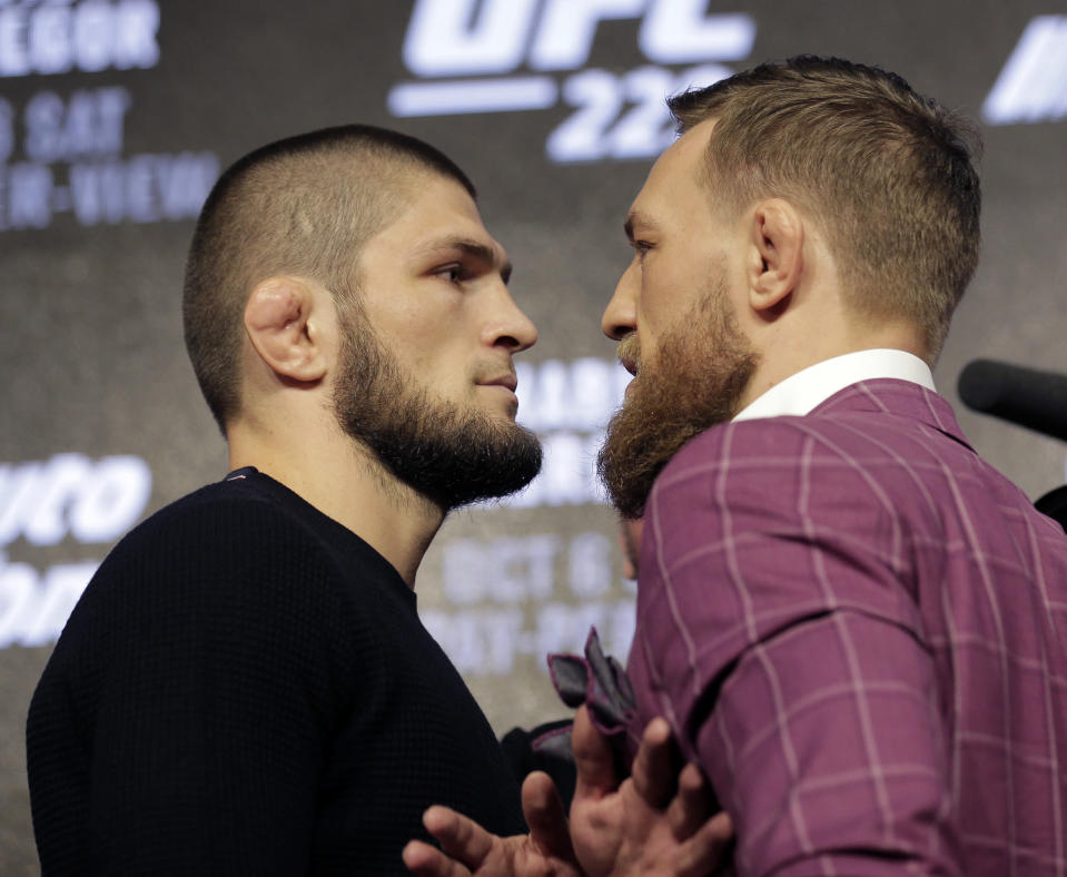 Conor McGregor and Khabib Nurmagomedov pose for pictures during a news conference in New York on Sept. 20, 2018. (AP Photo/Seth Wenig)