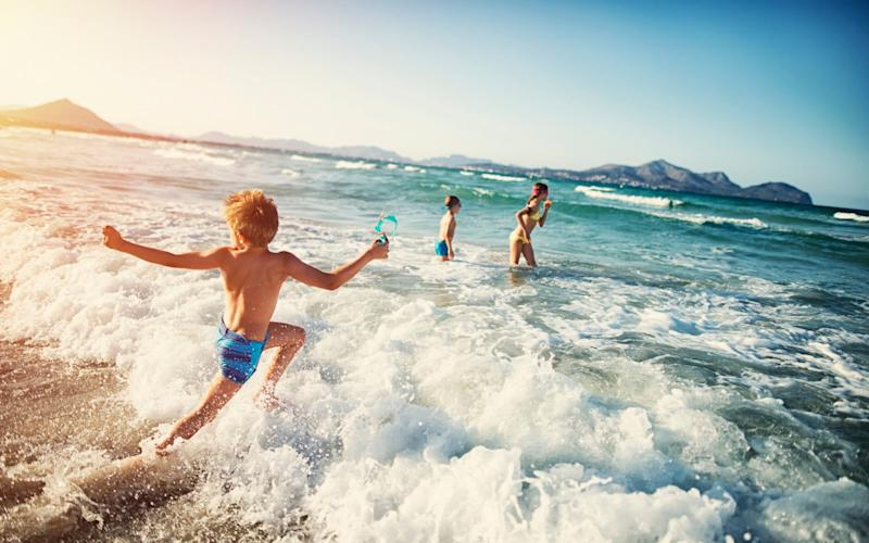 Children playing in the sea at the coast - Imgorthand/E+