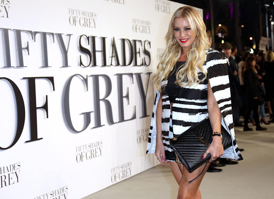 Denise Van Outen poses for photographers upon arrival at the UK premiere of the film 'Fifty Shades of Grey' in London, Thursday, Feb. 12, 2015. (Photo by Joel Ryan/Invision for Universal Pictures/AP Images)