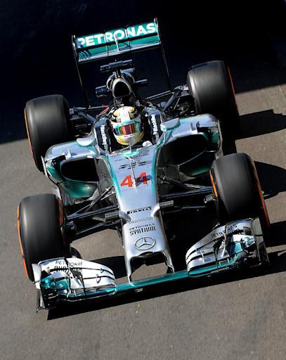 Britain's Lewis Hamilton of Mercedes exits the pit lane during first practice session before the Formula One British Grand Prix at Silverstone, England, on Friday, July 4, 2014. The British Formula One Grand Prix will be held on Sunday July 6, 2014. (AP Photo/Rui Vieira)