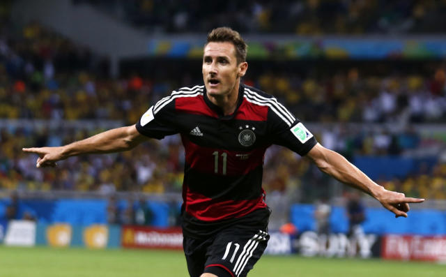 Germany's Miroslav Klose celebrates after scoring a goal during the 2014 World Cup semi-finals between Brazil and Germany at the Mineirao stadium in Belo Horizonte July 8, 2014. REUTERS/Marcos Brindicci (BRAZIL - Tags: TPX IMAGES OF THE DAY SOCCER SPORT WORLD CUP) TOPCUP