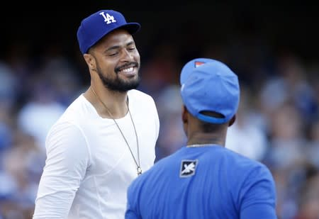 Tyson Chandler talks with The Game as they attend the MLB inter-league baseball game between the Red Sox and Dodgers in Los Angeles
