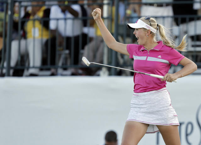 Jessica Korda of the U.S. celebrates on the 18th during the last day of the LPGA Pure Silk Bahamas Classic at the Ocean Club Golf Course, Paradise Island, Bahamas, Sunday, Jan. 26, 2014. Korda won the season-opening Bahamas LPGA Classic on Sunday for her second tour title. (AP Photo/Tim Aylen)