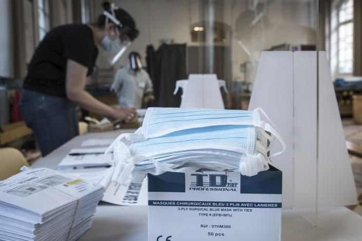 Protective face masks are pictured in a polling station during the second round of the municipal elections, Sunday, June 28, 2020 in Paris. France is holding the second round of municipal elections in 5,000 towns and cities Sunday that got postponed due to the country's coronavirus outbreak. (Joel Saget, Pool via AP)
