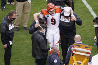 Cincinnati Bengals quarterback Joe Burrow (9) his help off the field during the second half of an NFL football game between against the Washington Football Team, Sunday, Nov. 22, 2020, in Landover. Burrow was carted off the field with a left knee injury. (AP Photo/Al Drago)