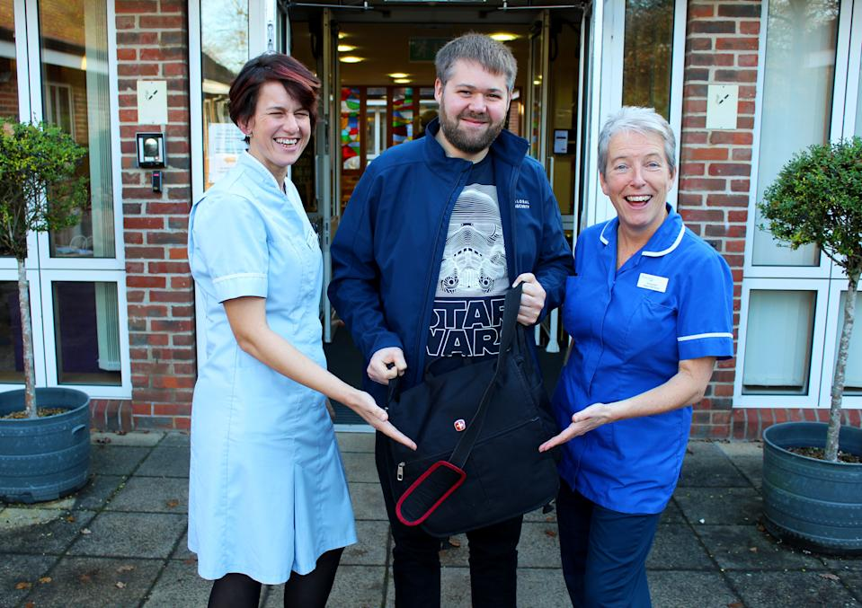 Lisa Davies (left), Health Care Support Worker, Disney Rep Jonathan Bush and Jill Saunders as he arrives with the latest Star Wars film to be shown to a dying patient and his son. (Credit: Rowans Hospice/PA Wire)