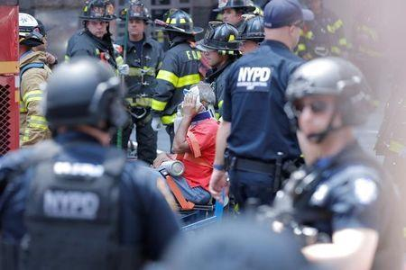 First responders tend to an injured pedestrian after a vehicle struck pedestrians on a sidewalk in Times Square in New York, U.S., May 18, 2017. REUTERS/Lucas Jackson