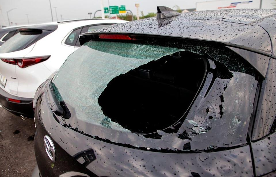 Storm damage to cars in Norman, Okla., on April 29, 2021, after a hail storm hit the area the day before.
