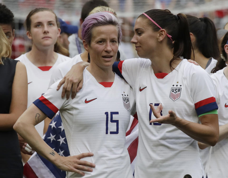 Megan Rapinoe and Alex Morgan voiced their disappointment at the judge's ruling in the equal pay case with US Soccer. (AP Photo/Alessandra Tarantino)