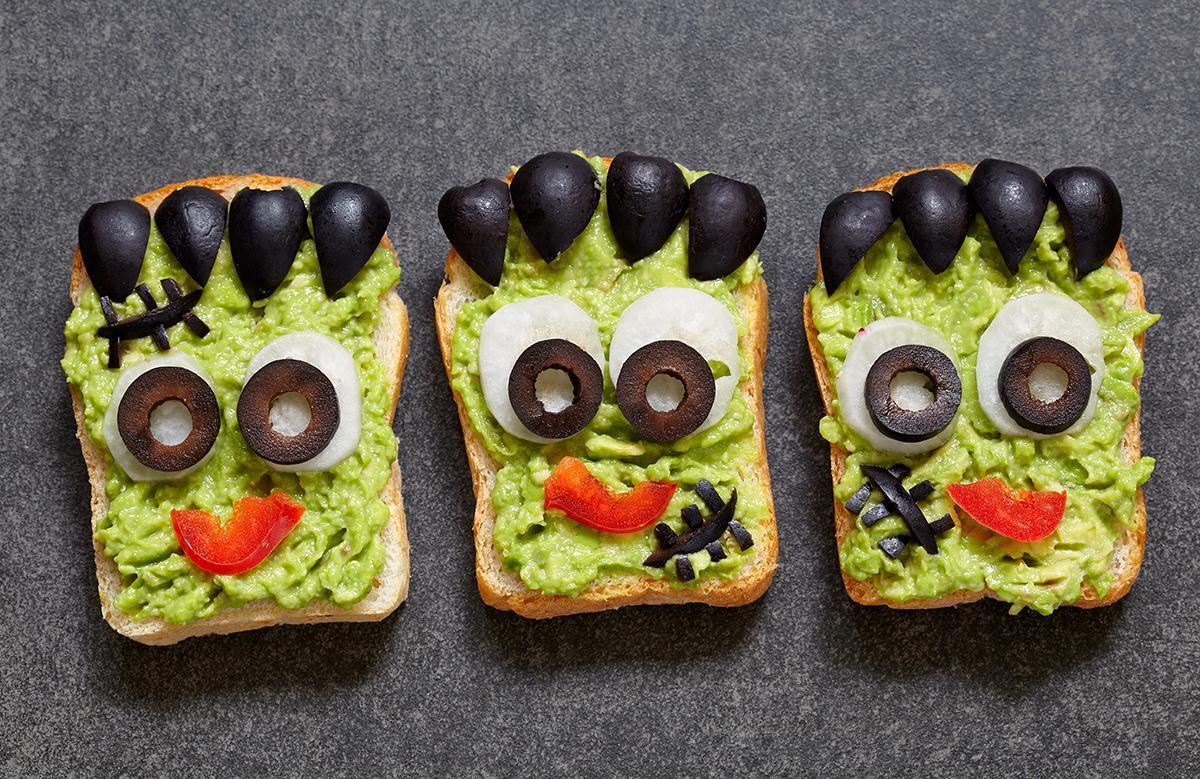 "<p>Avocados are packed with <a href=""https://www.thedailymeal.com/healthy-eating/most-common-nutrient-deficiency-america?referrer=yahoo&category=beauty_food&include_utm=1&utm_medium=referral&utm_source=yahoo&utm_campaign=feed"">nutrients</a> perfect for maintaining a <a href=""https://www.thedailymeal.com/healthy-eating/20-reasons-eat-avocado-every-day-slideshow?referrer=yahoo&category=beauty_food&include_utm=1&utm_medium=referral&utm_source=yahoo&utm_campaign=feed"">healthy diet</a>, so it makes sense to incorporate this snack into a fun treat for your Halloween party. Frankenstein toast is perfect for children and adults alike. Simply spread avocado on a bread of your choice and create fake spikes of hair with chopped olives or seaweed. The eyes can be made with egg whites from a boiled egg and olives, and a fun mouth can be created with a slice of tomato. This <a href=""https://www.thedailymeal.com/recipes/healthy-avocado-toast-recipe?referrer=yahoo&category=beauty_food&include_utm=1&utm_medium=referral&utm_source=yahoo&utm_campaign=feed"">avocado toast recipe</a> will help you get things started.</p>"