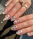 "<p>Here, <a href=""https://www.instagram.com/nailsbykassie/"" rel=""nofollow noopener"" target=""_blank"" data-ylk=""slk:Jones"" class=""link rapid-noclick-resp"">Jones</a> demonstrates how much multi-colored Christmas lights can brighten up a creamy neutral polish. </p><p><a class=""link rapid-noclick-resp"" href=""https://go.redirectingat.com?id=74968X1596630&url=https%3A%2F%2Fwww.etsy.com%2Flisting%2F399021689%2Frainbow-party-lights-christmas-new-year&sref=https%3A%2F%2Fwww.oprahmag.com%2Fbeauty%2Fg34113691%2Fchristmas-nail-ideas%2F"" rel=""nofollow noopener"" target=""_blank"" data-ylk=""slk:SHOP NAIL DECALS"">SHOP NAIL DECALS</a></p>"