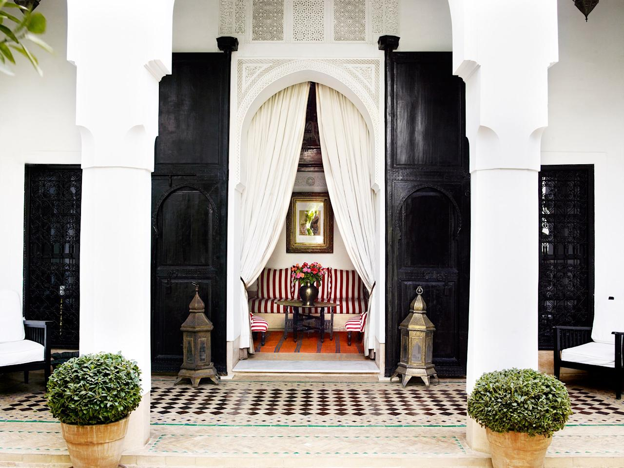 <p><strong>Set the scene for us.</strong><br> An incredibly refined take on a riad from an Englishman in Marrakech, Jasper Conran. This is an orange-blossom-scented, antique-filled retreat away from the hubbub. Serene, calm and elegant, this is a place to switch off from the noise of everyday life; to be still and silent.</p> <p><strong>What's the story with it?</strong><br> A converted 19th-century palace, the building had fallen into disrepair until British designer Jasper Conran happened upon it; this is his first foray into the hotel world after dreaming about owning one since he was a kid. Yet it doesn't really feel like a hotel, more like the exquisite home of a wealthy collector with impeccable taste. It's liberally dotted with the designer's personal collection of art and antiques, but still manages to feel pared-back—as if a Scandinavian fairy came down and waved all the potential clutter away.</p> <p><strong>Sounds lovely. Tell us about the bedrooms.</strong><br> The Casablanca Suite is presided over by a spectacular painting of one of the maharajas of India. Its king-sized four-poster bed is draped in snowy voile, and it has a hand-painted ceiling inlaid with gold leaf and a deep, caramel-toned tadelakt tub. There are more antiques in here than any of the other rooms, so if you're feeling clumsy, choose the Zagora Suite—smaller, but light and airy, with the added bonus of a leafy private terrace that leads directly onto the pool.</p> <p><strong>How about the food and drink?</strong><br> The bar, with its crimson- and- white-striped lounge chairs, is a brilliant spot for a martini before dinner, or a digestif before bed, or for settling in with a book and glass of meaty local red on a chilly winter's day. The dining room feels more summery—its wall of glass doors open directly onto the lush green courtyard. It serves traditional Moroccan home cooking, but you can also get a decent steak frites if you want.</p> <p><strong>Does anything stand out about the s