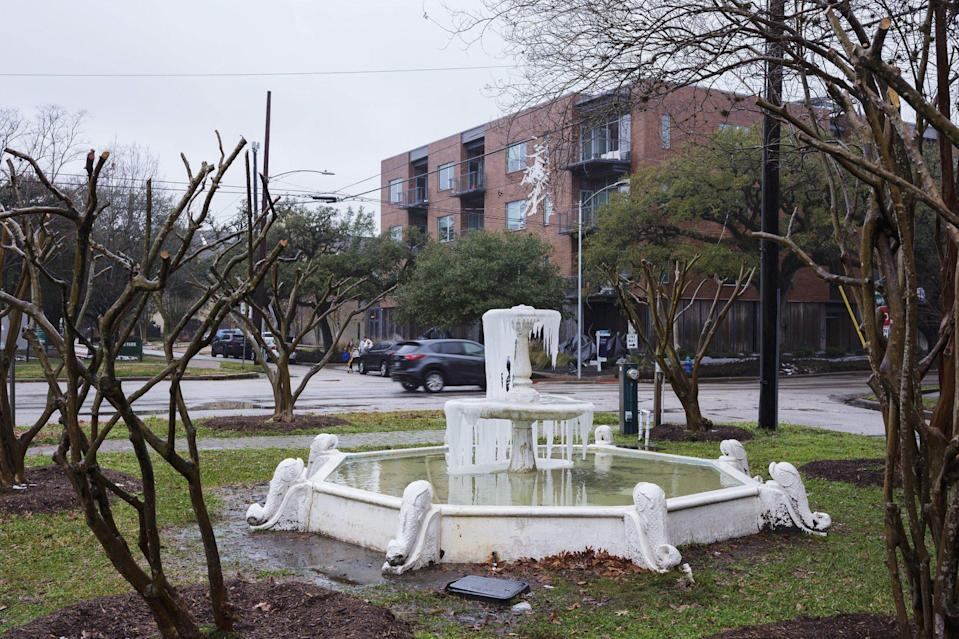 <p>A water fountain is frozen over in the Hyde Park neighborhood of Houston, Texas, on Feb. 17. </p>