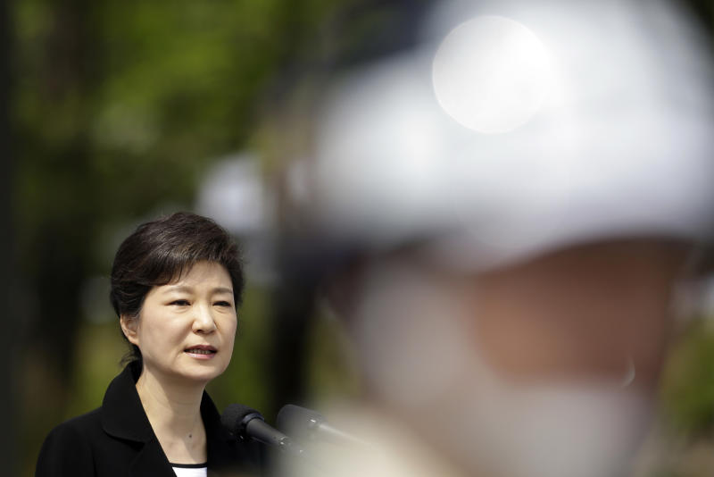 South Korean President Park Geun-hye delivers a speech as a military soldier stands guard during a 58th Memorial Day ceremony at the National Cemetery in Seoul, South Korea, Thursday, June 6, 2013. (AP Photo/Lee Jin-man, Pool)