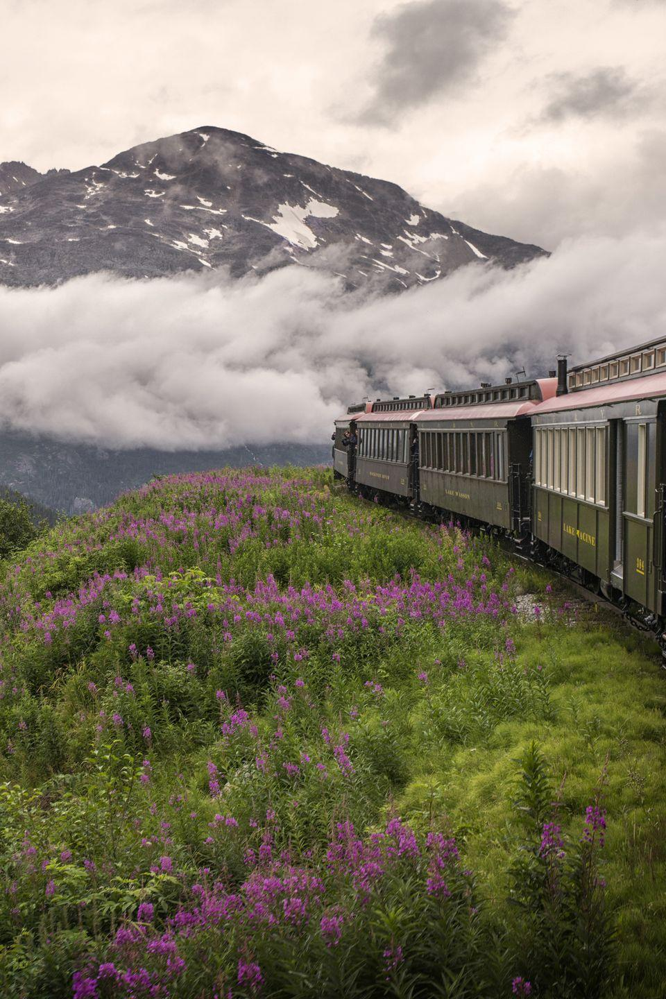 """<p><strong>Where:</strong> White Pass and Yukon Route Railroad, Alaska</p><p><strong>Why We Love It: </strong>Built in the late 19th century during the Klondike Gold Rush, this scenic railroad climbs nearly 3,000 feet in 20 miles giving riders panoramic (and cliff-hanging!) views of the surrounding mountains.<br></p><p><strong>RELATED:</strong> <a href=""""https://www.countryliving.com/life/travel/g2312/scenic-train-rides-across-america/"""" rel=""""nofollow noopener"""" target=""""_blank"""" data-ylk=""""slk:The Most Scenic Train Rides In North America"""" class=""""link rapid-noclick-resp"""">The Most Scenic Train Rides In North America</a><br></p>"""