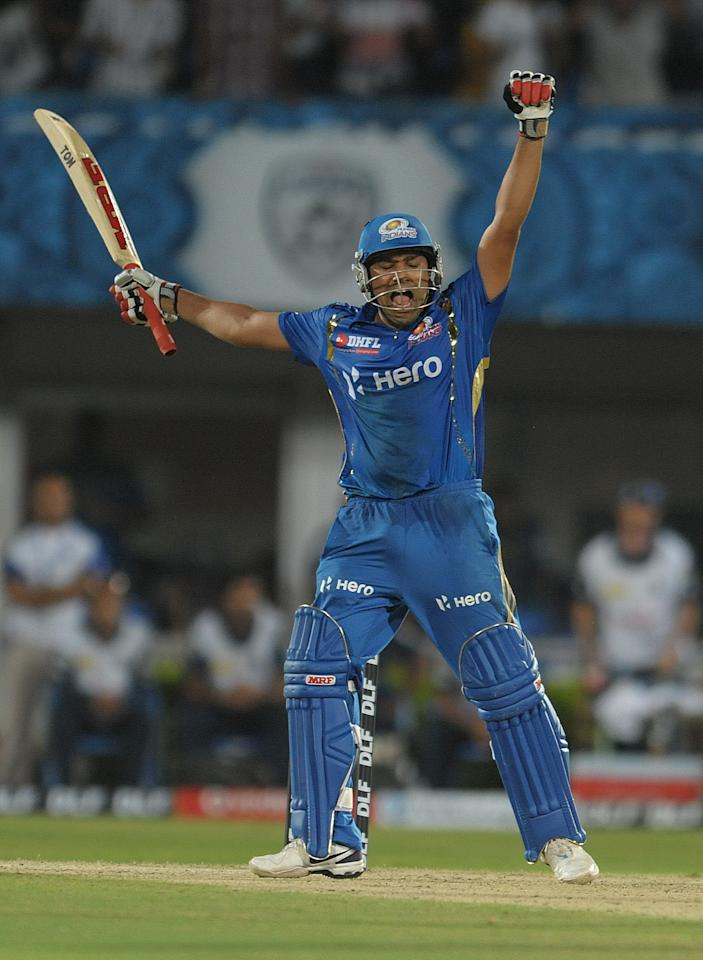 Mumbai Indians batsman Rohit Sharma celebrates after winning shot on April 9, 2012 during the IPL Twenty20 cricket match against the Deccan Chargers at the Dr. Y.S. Rajasekhara Reddy Cricket Stadium in Visakhapatnam.                            AFP PHOTO / NOAH SEELAM RESTRICTED TO EDITORIAL USE. MOBILE USE WITHIN NEWS PACKAGE (Photo credit should read NOAH SEELAM/AFP/Getty Images)