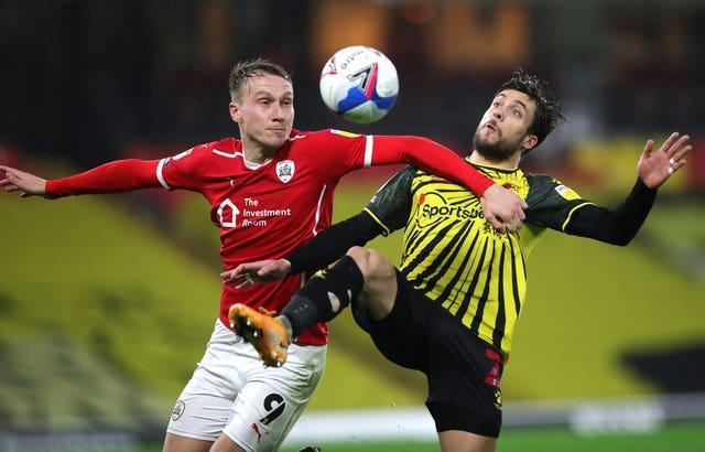 Cauley Woodrow, left, has chipped in with 12 league goals for Barnsley this season
