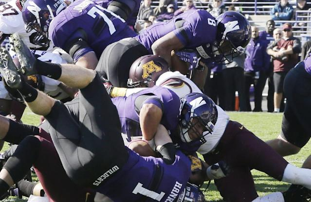 Northwestern running back Stephen Buckley (8) scores a touchdown during the first half of an NCAA college football game against Minnesota Saturday, Oct. 19, 2013, in Evanston, Ill. (AP Photo/Nam Y. Huh)