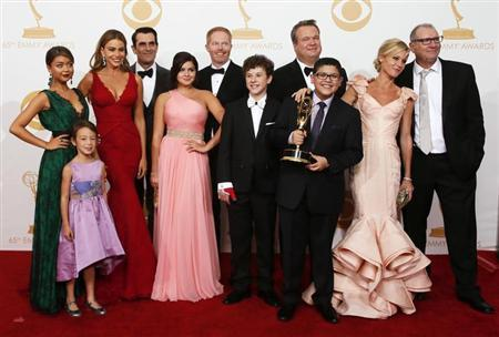 "The cast of ABC's series ""Modern Family"" poses backstage with their award for Outstanding Comedy Series at the 65th Primetime Emmy Awards in Los Angeles September 22, 2013. REUTERS/Lucy Nicholson"