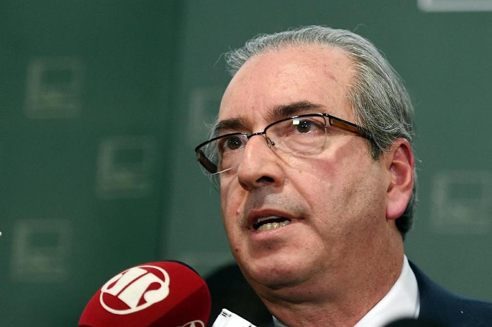 Right-wing legislator Eduardo Cunha, president of the Brazilian Chamber of Deputies and a critic of president Dilma Rousseff, appeared on December 7, 2015 to postpone the installation of a special committee which will consider Rousseff's impeachment (AFP Photo/Evaristo Sa)