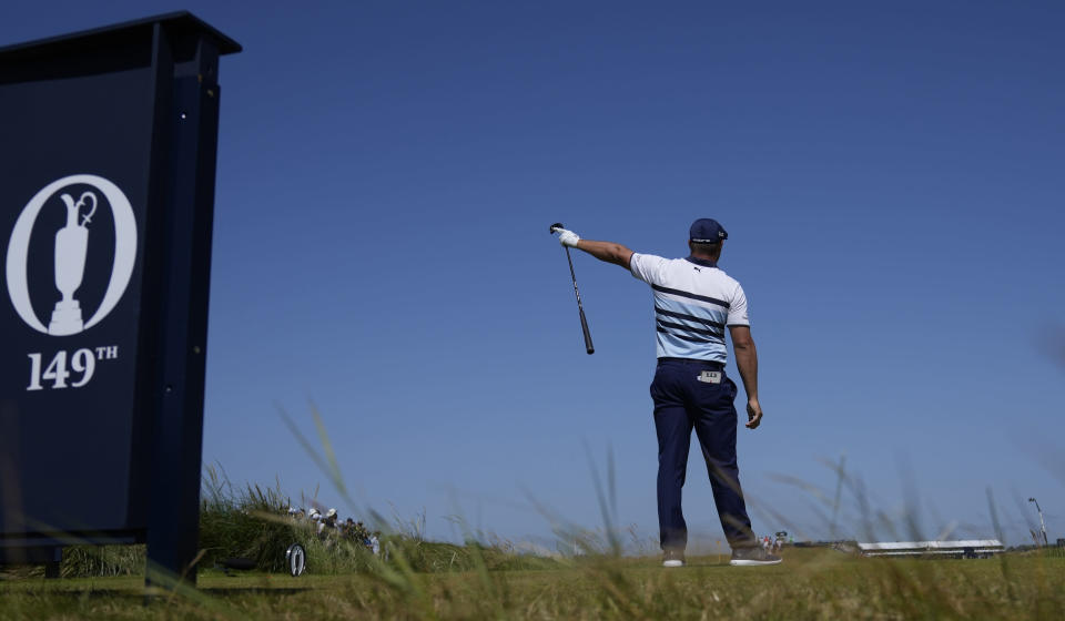United States' Bryson DeChambeau gestures as his ball goes left from the tee after his drive from the 9th during the third round of the British Open Golf Championship at Royal St George's golf course Sandwich, England, Saturday, July 17, 2021. (AP Photo/Alastair Grant)
