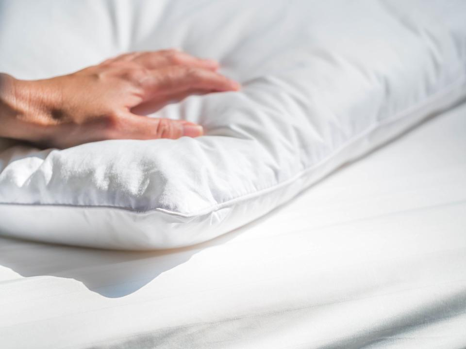 Add a dust mite cover to pillows and mattress to reduce allergies. (Photo: Getty)