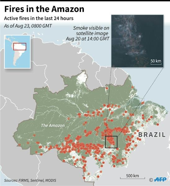Map showing fires in the Amazon over the last 24 hours, with a satellite image showing smoke in the region. (AFP Photo/Simon MALFATTO)