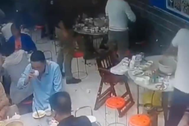 Huge ball of fire bursts out of cigarette as Chinese man lights it in restaurant with gas leak