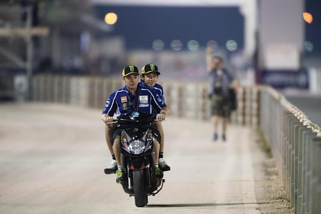 DOHA, QATAR - MARCH 20: Valentino Rossi of Italy and Movistar Yamaha MotoGP in scooter in service road during the MotoGp of Qatar - Free Practice at Losail Circuit on March 20, 2014 in Doha, Qatar. (Photo by Mirco Lazzari gp/Getty Images)